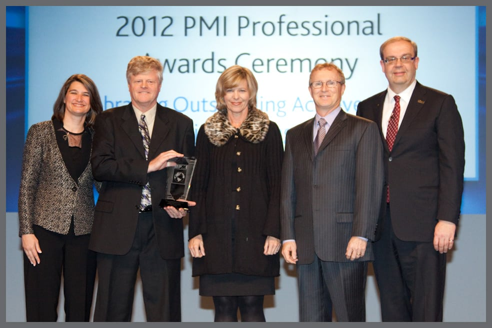 From the left, Deanna Landers, PMI Vice Chair; Dave Tillery, Fissure Developer; Lori Tillery, Fissure Developer;Jesse Freese, Fissure President; Peter Monkhouse, PMI Chair